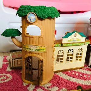 Calico critters school house with accessories.